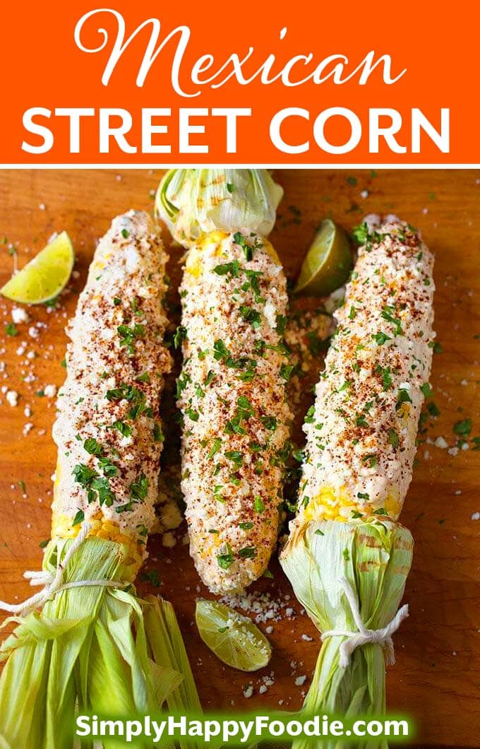 Mexican Street Corn (Elotes) is lightly grilled corn on the cob slathered with a creamy, spicy cheese mixture. Grilled corn on the cob that is super flavorful! simplyhappyfoodie.com #mexicanstreetcorn #cornonthecob #elotes #grilledcornonthecob