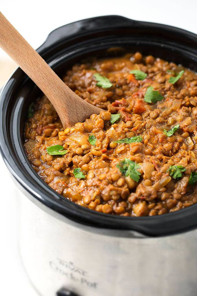 Crock Pot Curry Lentils in a crock pot with wooden serving spoon