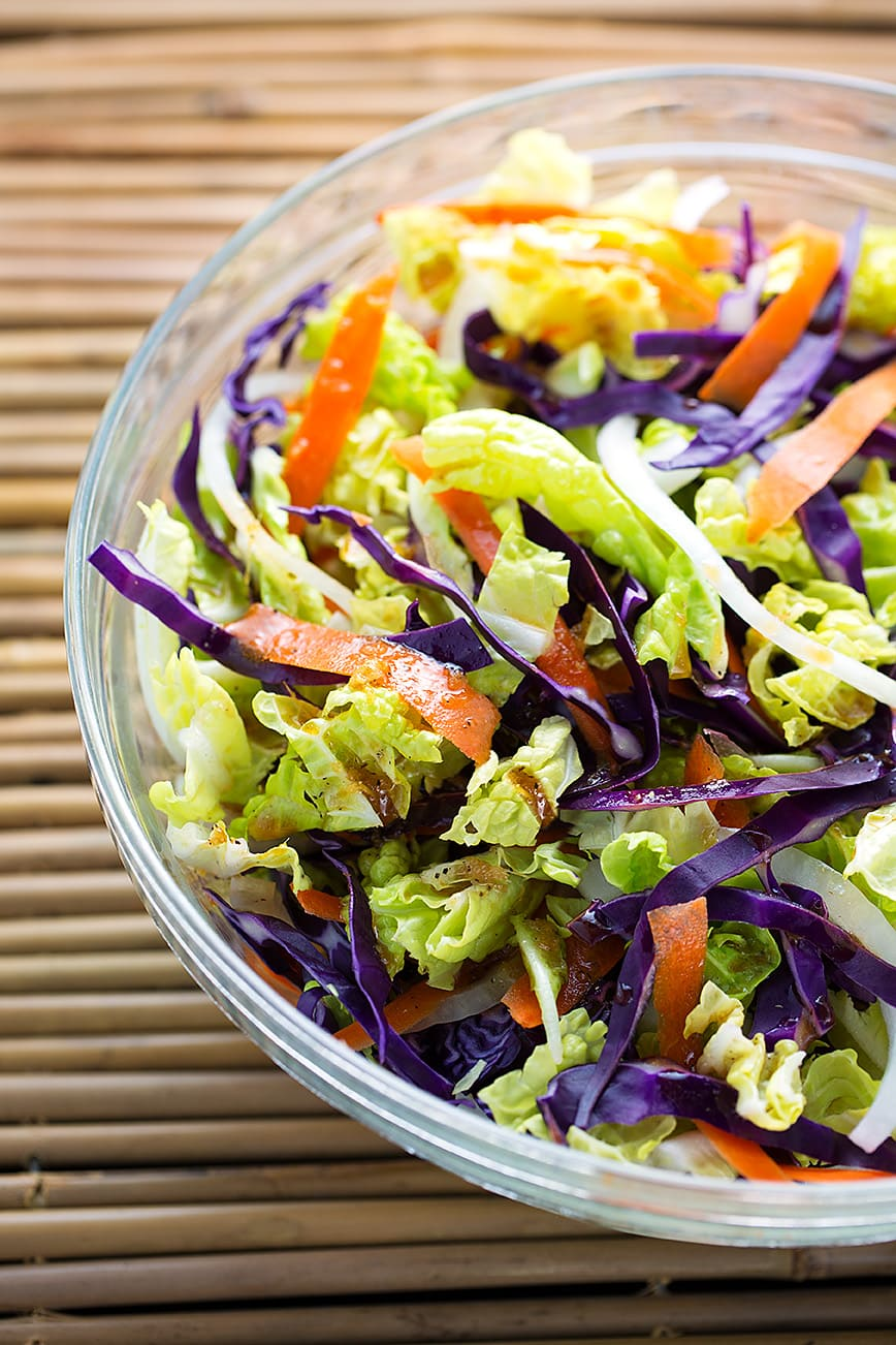 Bowl of Fresh Asian Slaw on a bamboo mat