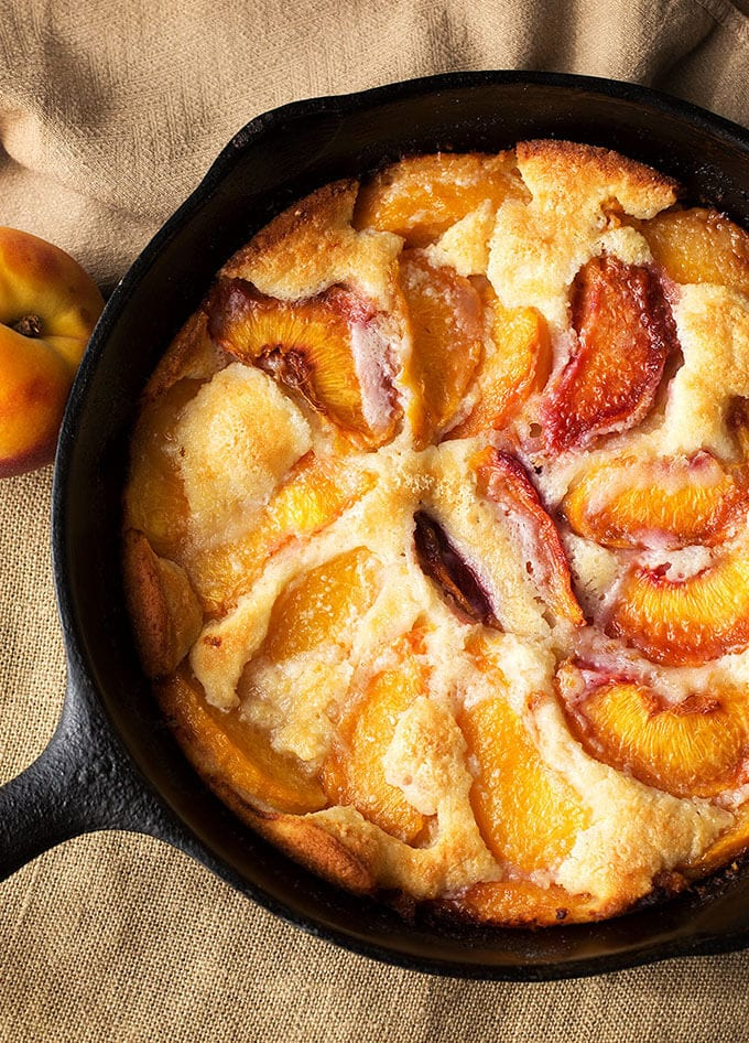 Fresh Peach Cobbler with a hint of almond is so yummy, and easy to make. simplyhappyfoodie.com