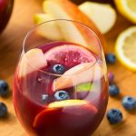Fruity Red Sangria in a stemless wineglass