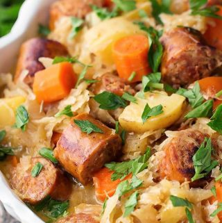 Instant Pot Kielbasa and Sauerkraut is a one pot meal with amazing flavor. Easy to make! simplyhappyfoodie.com #instantpotrecipes #instantpotkielbasa #instantpotsauerkraut