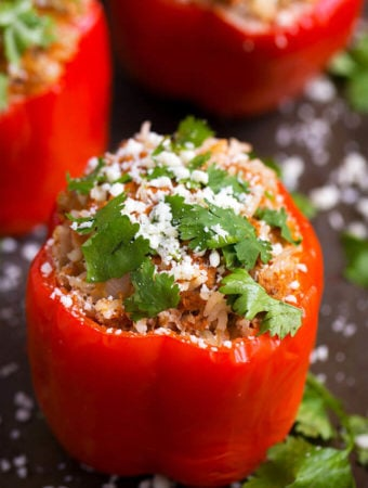Instant Pot Mexican Stuffed Peppers are so easy to make, and ready in under an hour! Great weeknight meal. simplyhappyfoodie.com #instantpotrecipes #instantpotstuffedpeppers #pressurecookerstuffedpeppers