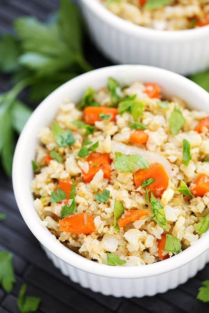 Roasted Cauliflower Rice with Carrots in a small white bowl