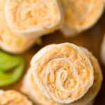 Buffalo Chicken Pinwheels have the wing flavor in a neat pinwheel appetizer. Great for a party or game day! simplyhappyfoodie.com