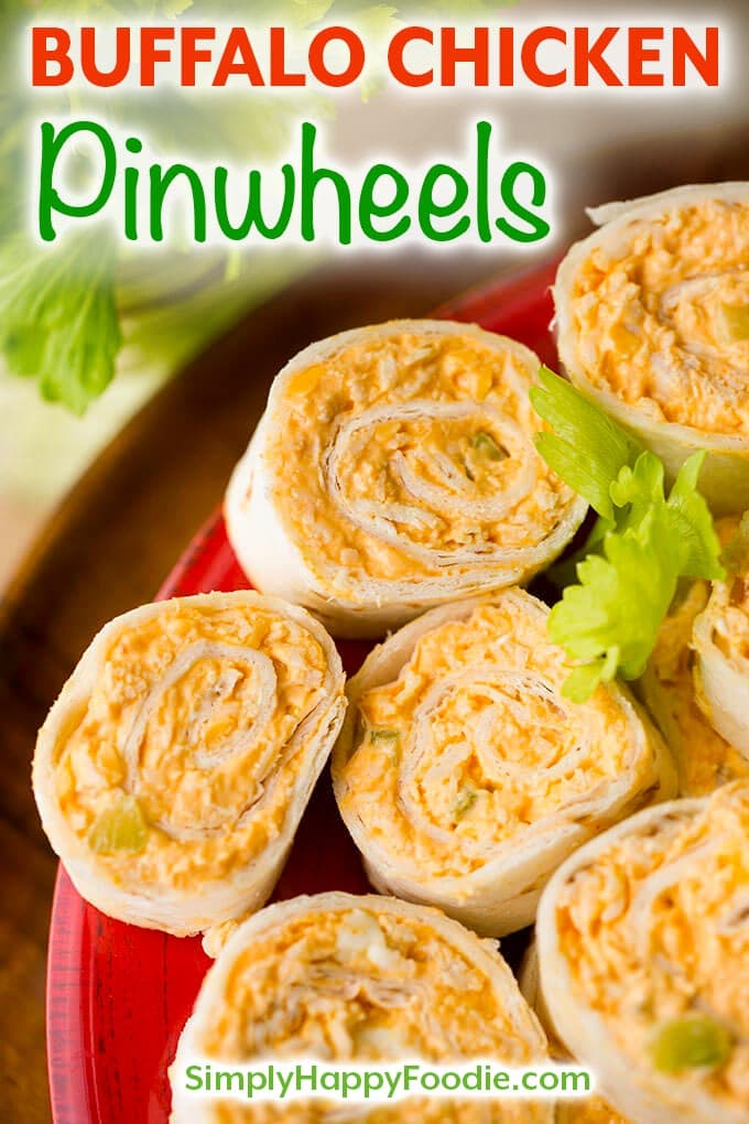 Buffalo Chicken Pinwheels have buffalo wings flavor in a neat pinwheel appetizer. Great party or game day appetizer! simplyhappyfoodie.com #gamedayfood #pinwheelrecipe #buffalochicken pinwheel appetizer