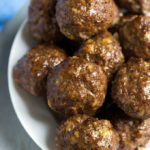 Easy Baked Meatballs have amazing flavor, and are ready in under an hour. We love them in spaghetti! simplyhappyfoodie.com
