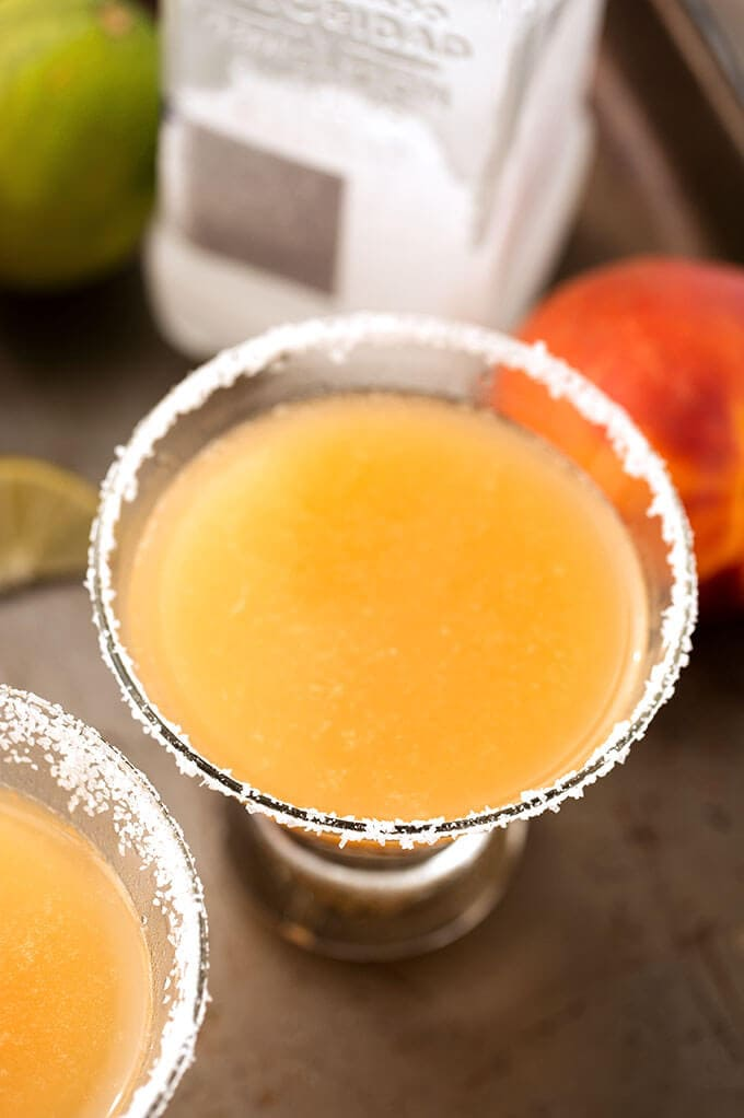 This Fancy Peach Margarita is so delicious and perfect for a party or a backyard barbecue! simplyhappyfoodie.com
