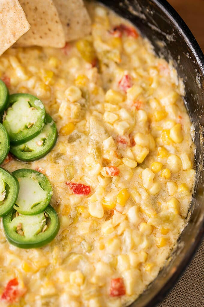 Hot Cheesy Corn Dip is a flavorful game day and party favorite. With corn, green chilis and cheese, we love this dip. simplyhappyfoodie.com #corndip #gameday #appetizer