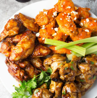 Instant Pot Chicken Wings are a tasty game day appetizer. Try these with 3 different sauces. simplyhappyfoodie.com #instantpotwings