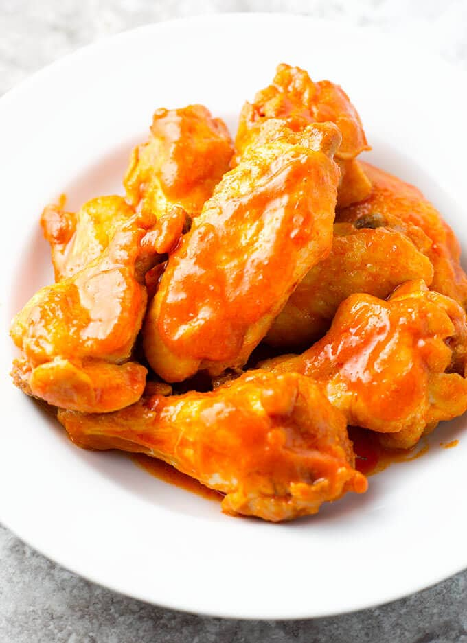 Instant Pot Chicken Wings are a tasty game day appetizer. Try these with 3 different sauces. simplyhappyfoodie.com