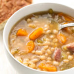 Instant Pot Ham Hock and Bean Soup is a hearty classic you can make in your pressure cooker. Great flavor! simplyhappyfoodie.com #instantpotrecipes #instantpotsoup #instantpothamhock #instantpotbeans
