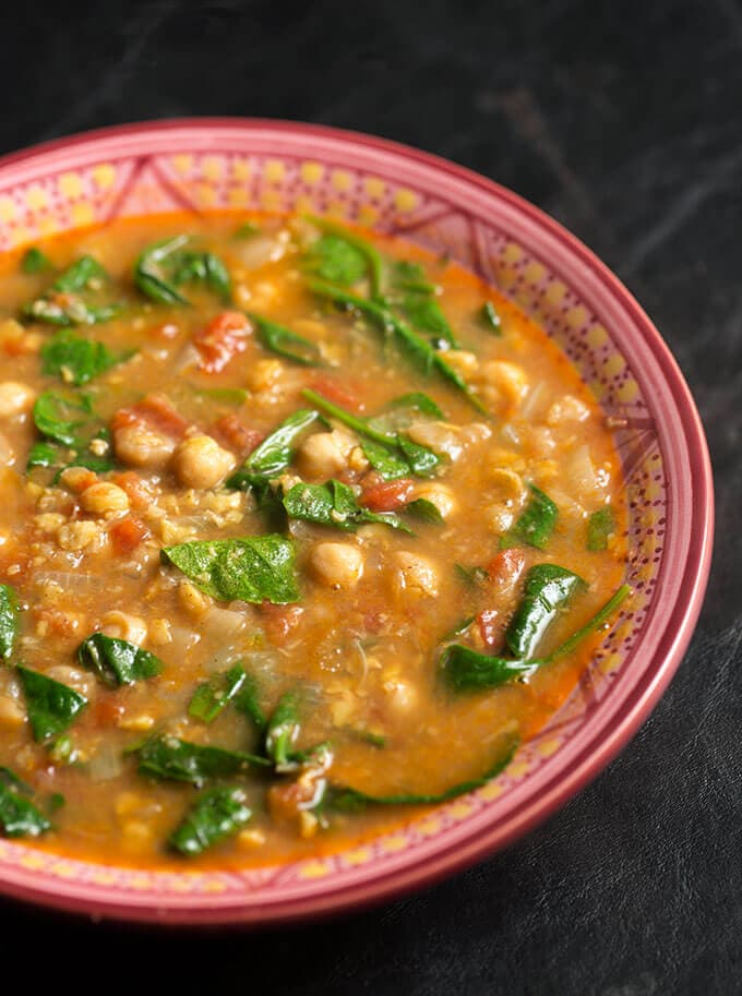 Instant Pot Moroccan Chickpea Stew in patterned bowl on a dark background