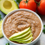 Instant Pot Refried Beans are way better than the canned stuff. Ready from dry beans in just over an hour! Lots of flavor. simplyhappyfoodie.com #instantpotrecipes #instantpotrefriedbeans #pressurecookerrefriedbeans