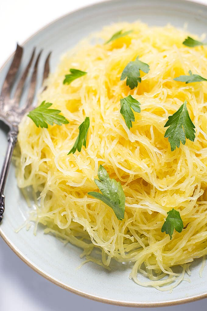 Instant Pot Spaghetti Squash is fast and easy to cook. Pressure cooker spaghetti squash is a healthy and easy way to cook this awesome veggie! simplyhappyfoodie.com #instantpotrecipes #spaghettisquash instant pot vegetables