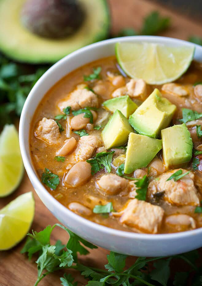 Instant Pot White Chicken Chili has a great Tex-Mex flavor with chicken, white beans, and green chilis. We love it with tortillas and avocado. simplyhappyfoodie.com #instantpotrecipes #instantpotchili