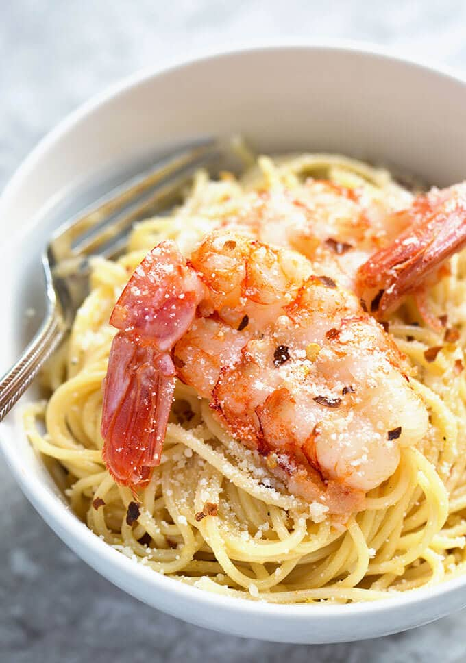 Close up of Lemony Capellini with Shrimp with a fork in a white bowl