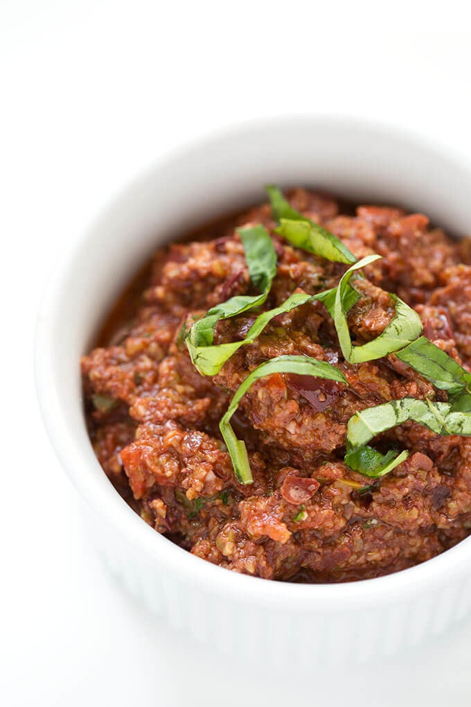 Olive Tapenade in small white bowl on white background