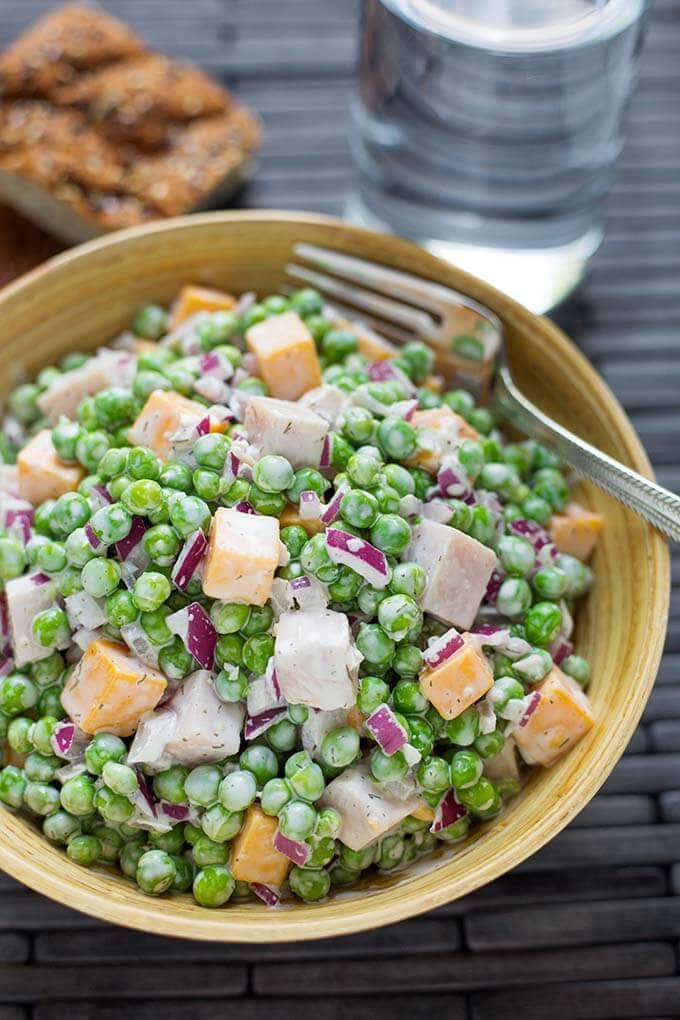 Pea Salad with Smoked Turkey is a tasty side or a main dish pea salad recipe. You can make this a pea salad with bacon, or a pea salad with ham, too. Simply delicious! simplyhappyfoodie.com #peasalad #peasaladrecipe