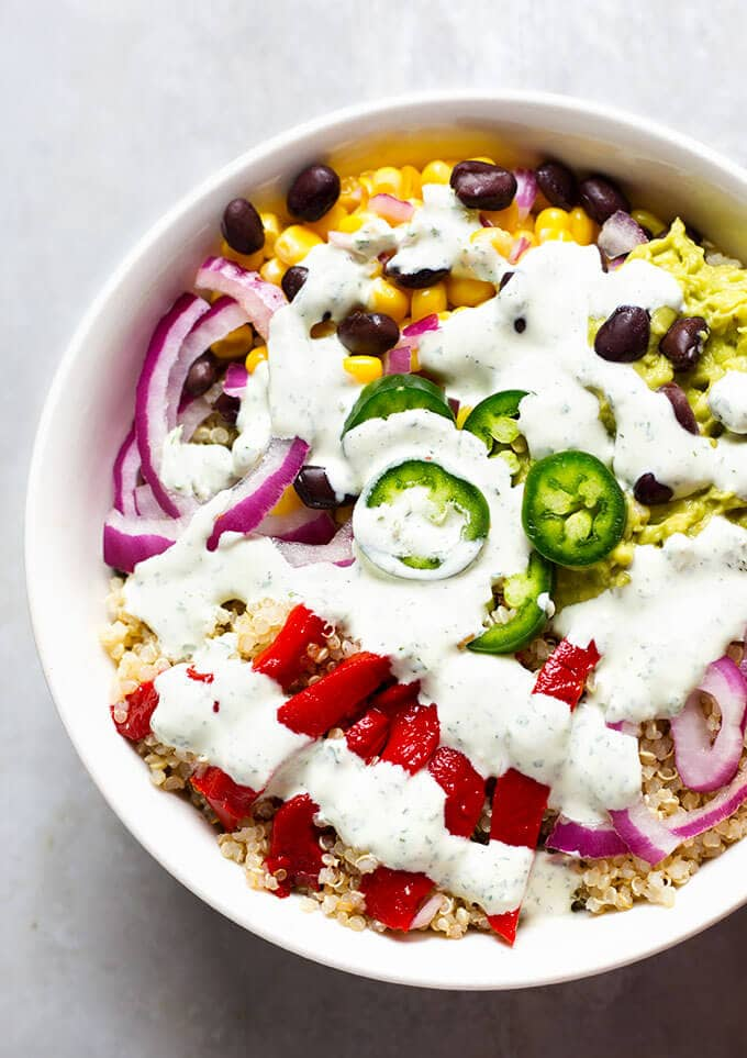 Southwest Quinoa Bowl with Cilantro Dressing is packed with amazing flavors! Good enough to share. Or not! simplyhappyfoodie.com