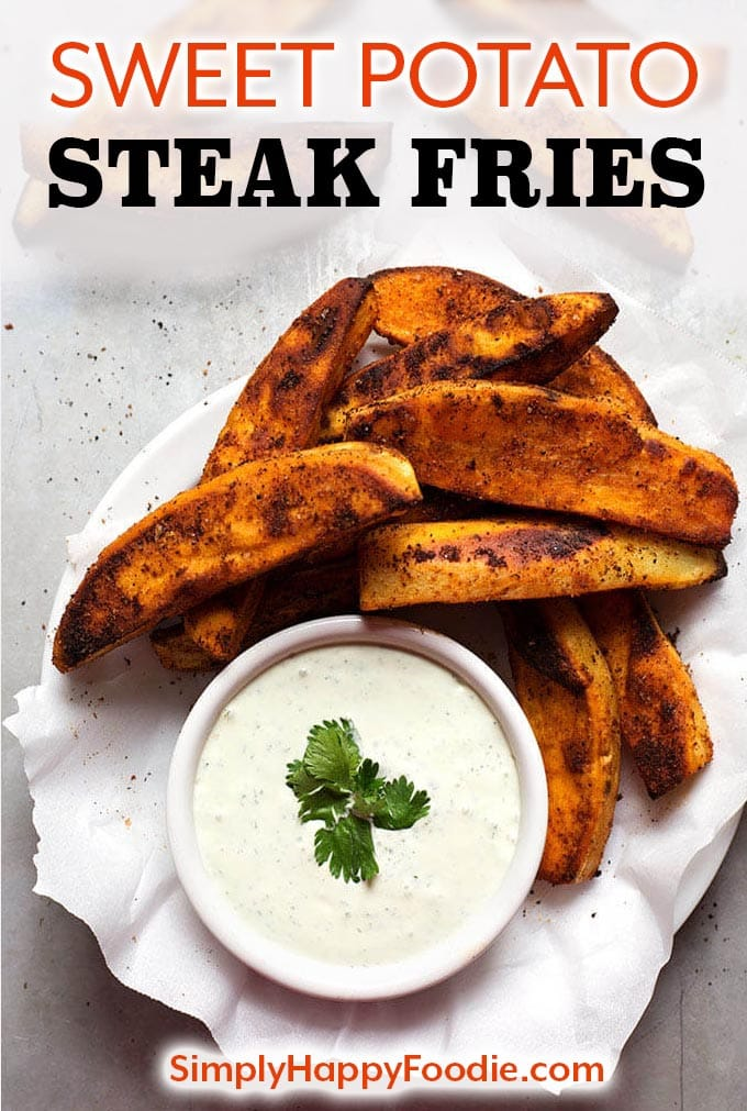 Sweet Potato Steak Fries are oven baked, slightly spicy, healthy, and delicious! Baked Sweet Potato Fries have lots of flavor and are easy to make. simplyhappyfoodie.com #sweetpotatosteakfries #sweetpotatofries #bakedsweetpotatoes