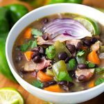 Hatch Green Chile Black Bean Soup is spicy and hearty, and tasty! simplyhappyfoodie.com #hatchchiles #hatchchile #blackbeansoup #hatchchilerecipes