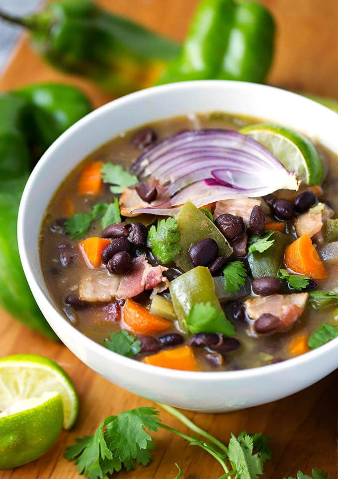 Hatch Green Chile Black Bean Soup is spicy, healthy, hearty, and tasty! A perfect end of summer soup to use your Hatch Green Chiles in. This Hatch Green Chile soup is easy and fast to make. simplyhappyfoodie.com #hatchchileblackbeansoup #hatchchiles #hatchchile #blackbeansoup #hatchchilerecipes