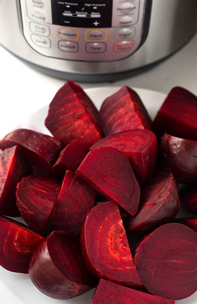 Instant Pot Beets are easy to cook and turn out tender, delicious, and healthy. Pressure cooker beets take less time than oven or stovetop. simplyhappyfoodie.com #beets #howtocookbeets #instantpotbeets #howtocookbeetsintheinstantpot