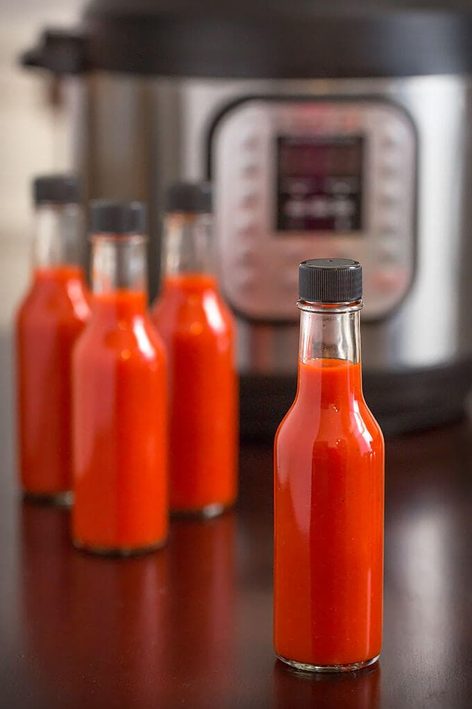 . Make homemade hot sauce in your Instant Pot pressure cooker! Tasty and easy hot sauce recipe! simplyhappyfoodie.com #homemadehotsauce #hotsaucerecipe #instantpothotsauce