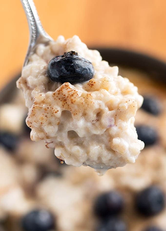 Close up of silver spoon with Steel Cut Oats