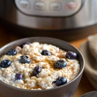Instant Pot Steel Cut Oats are easy and creamy, with a bit of texture. Add in your favorite flavors for a tasty breakfast! simplyhappyfoodie.com #instantpotrecipes #instantpotoatmeal #instantpotsteelcutoats #instantpot