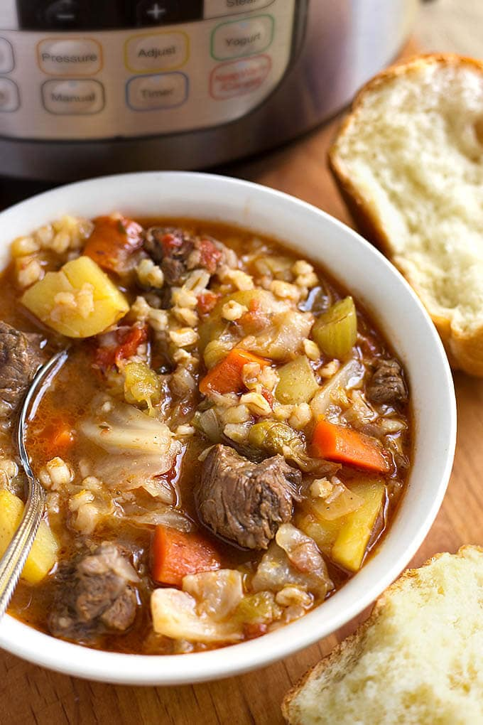 Instant Pot Beef Barley Vegetable Soup is Nana's recipe and tastes like home. Hearty and comforting, with lots of flavor! simplyhappyfoodie.com #beefbarleysoup #instantpotbeefbarleysoup