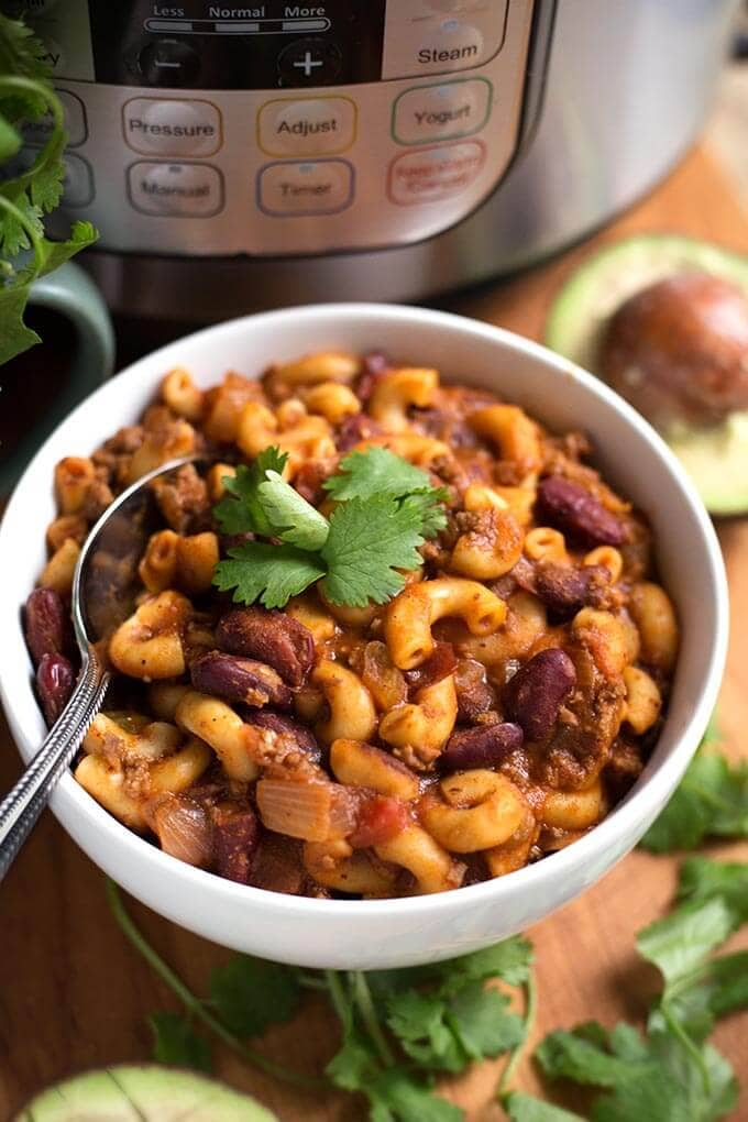 Instant Pot Chili Mac is a filling one pot pasta meal made in your electric pressure cooker. Tasty! simplyhappyfoodie.com #instantpotrecipes #instantpotpasta #instantpotchilimac #instantpotmacandcheese