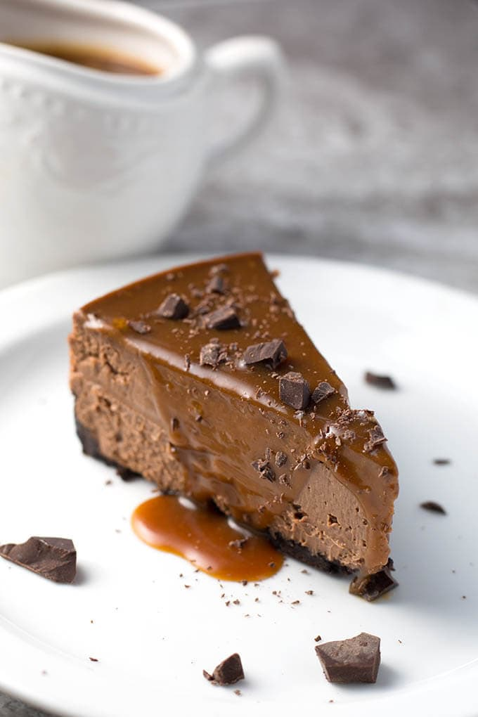 Instant Pot Chocolate Cheesecake is rich and creamy and chocolatey! This is an awesome chocolate cheesecake you make in your pressure cooker! simplyhappyfoodie.com #instantpotcheesecake #pressurecookercheesecake