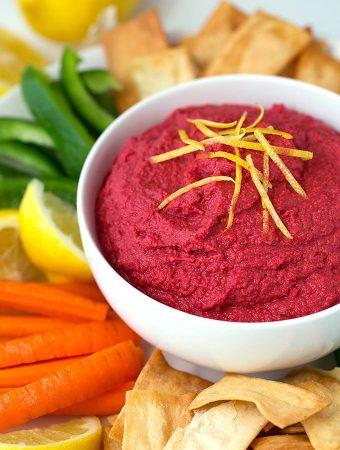 Red Beet Hummus is a sweeter hummus dip. We love it on carrots and pita chips! simplyhappyfoodie.com #hummus #beethummus