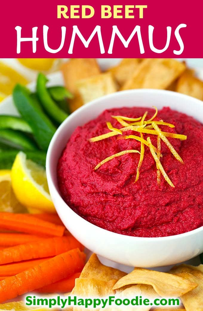Red Beet Hummus is a sweeter version of the wonderful Classic Hummus. Featuring red beets, garlic, and a small amount of tahini for an earthy flavor. This Red Beet Hummus tastes great on pita chips, carrot sticks, and on a sandwich or wrap! simplyhappyfoodie.com #redbeethummus #beethummusrecipe
