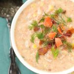 Tasty Salmon Chowder is perfect for using leftover salmon. simplyhappyfoodie.com #salmonchowder #leftoversalmon