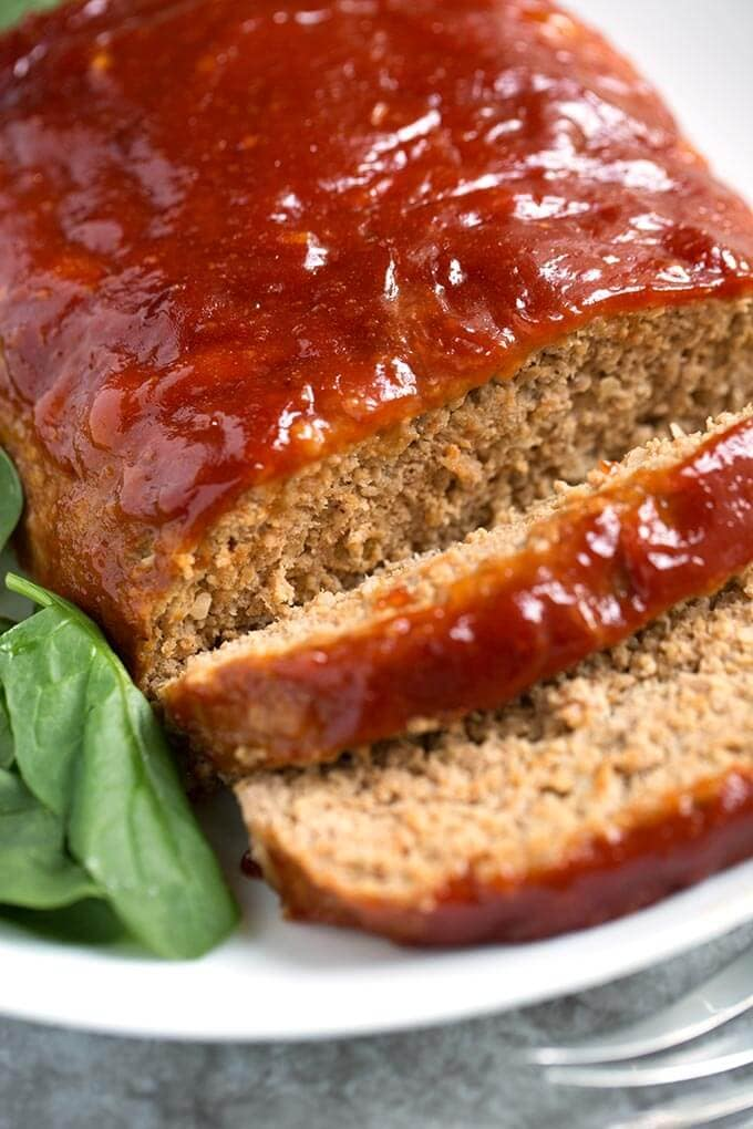 This Tasty Turkey Meatloaf is flavorful and juicy. The best turkey meatloaf recipe I've eaten! Easy to make and the family will love it! simplyhappyfoodie.com #meatloaf #turkeymeatloaf #bestmeatloaf