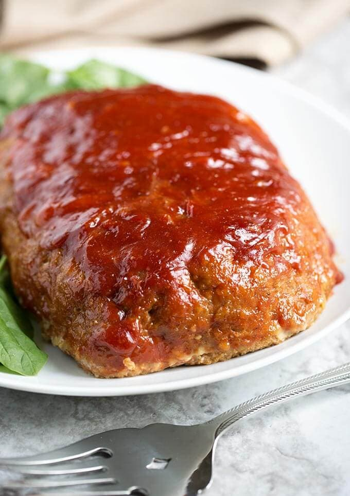This Tasty Turkey Meatloaf is flavorful and juicy. Easy to make and the family will love it! simplyhappyfoodie.com #meatloaf #turkeymeatloaf #bestmeatloaf #meatloafrecipes