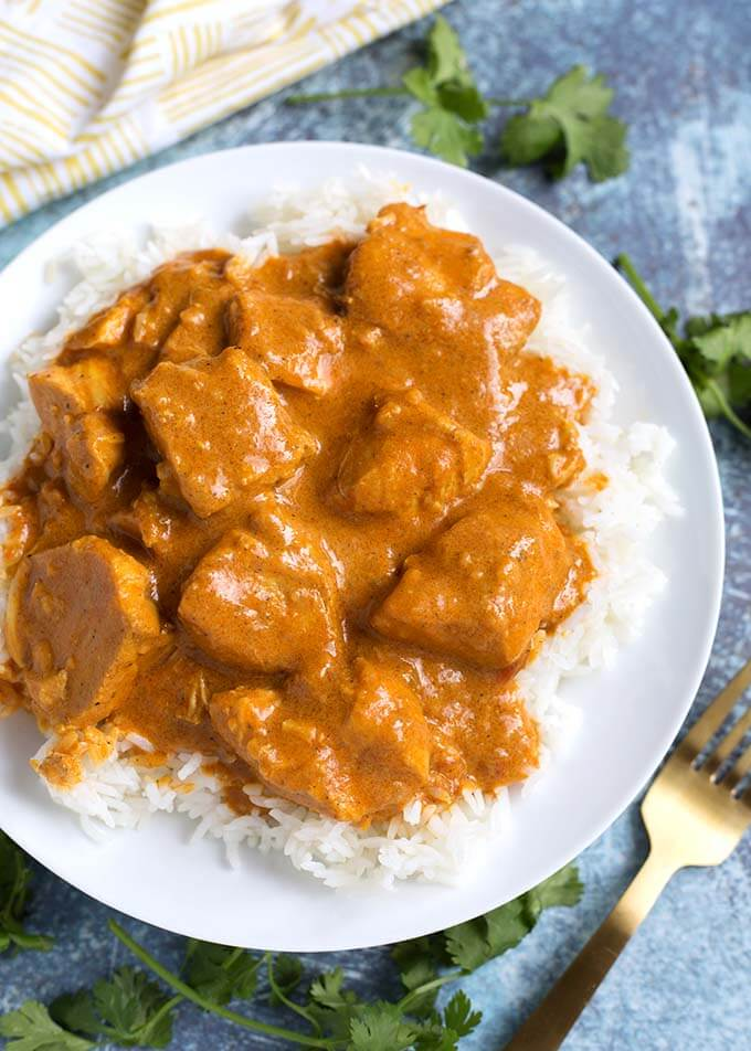 Instant Pot Butter Chicken is rich and super flavorful. We like making this awesome tasting and easy pressure cooker Butter Chicken, and even our picky eaters like it! simplyhappyfoodie.com #instantpotbutterchicken #pressurecookerbutterchicken
