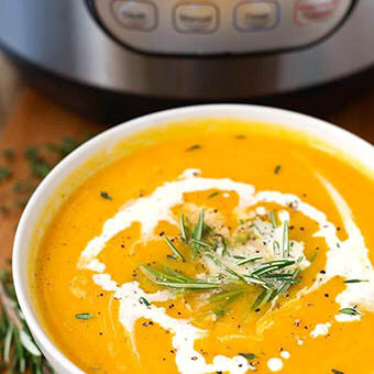 Instant Pot Butternut Squash Soup is a flavorful and healthy Fall soup. We love this soup with warm bread! simplyhappyfoodie.com #butternutsquashsoup #instantpotrecipes #instantpotsoup #instantpotbutternutsquashsoup