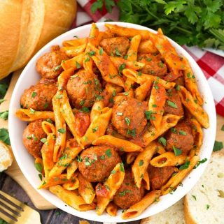 Instant Pot Meatball Pasta Dinner is a hearty pasta meal made with frozen pre-cooked meatballs. This pressure cooker meatball pasta is an easy weeknight meal in under an hour! simplyhappyfoodie.com #instantpotmeatballspasta #pressurecookermeatballpasta