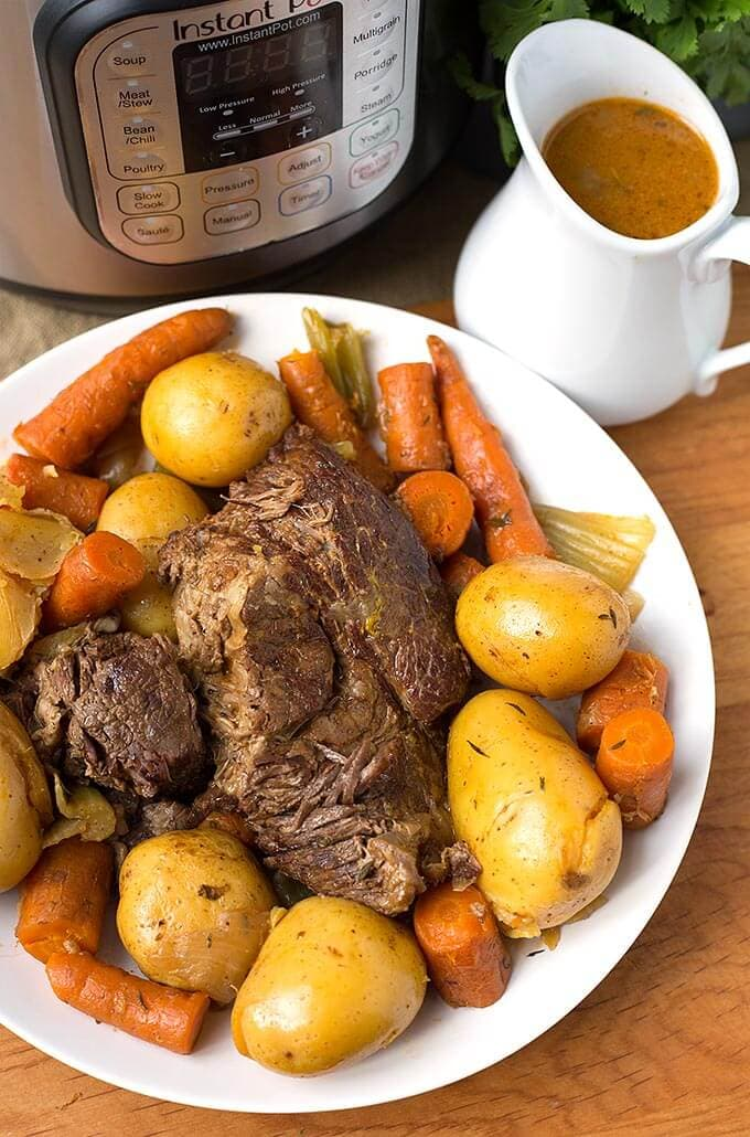 Delicious, comforting, and easy. Instant Pot Simple Pot Roast is the most tender and flavorful pot roast, cooked in your electric pressure cooker. simplyhappyfoodie.com #potroast #instantpotrecipes #instantpotpotroast #pressurecookerpotroast