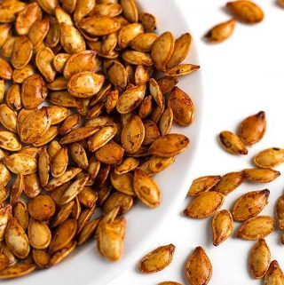 Roasted Pumpkin Seeds are a tasty and healthy snack. We enjoy them with different flavors, and this method works with all squash seeds. Roasted squash seeds are such a great treat! simplyhappyfoodie.com #roastedpumpkinseeds #pumpkinseeds How to roast pumpkin seeds, how to roast squash seeds