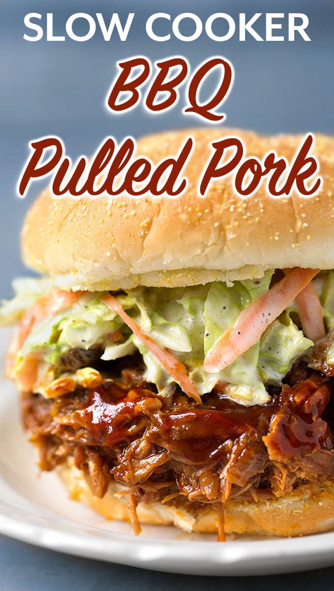 Very tasty Slow Cooker BBQ Pulled Pork will feed the whole family. This crock pot bbq pulled pork is easy to make on a busy day. Just set it and go! simplyhappyfoodie.com #pulledpork #bbqpulledpork #barbecuepulledpork #slowcookerpulledpork #crockpotpulledpork