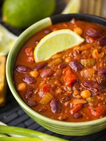 Instant Pot Chili is rich and hearty with beans and tomatoes, and lots of flavor. Pressure cooker chili is easy and fast! simplyhappyfoodie.com #instantpotrecipes #instantpot #instantpotchili #instapotchili