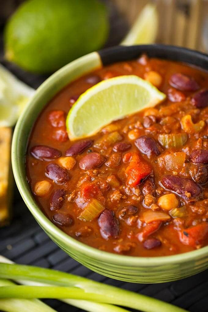 Instant Pot Chili is rich and hearty with beans and tomatoes, and lots of flavor. Pressure cooker chili is easy and fast! simplyhappyfoodie.com #instantpotrecipes #instantpotchili #pressurecookerchili