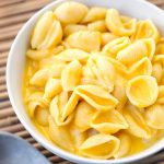 Instant Pot Mac and Cheese is simple, creamy, cheesy, and delicious. Make this fast in your electric pressure cooker, and in one pot! simplyhappyfoodie.com #instantpotmacandcheese #instantpotrecipes #instapot