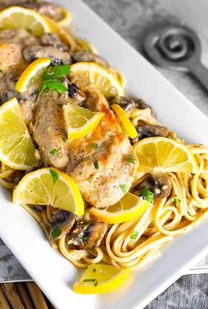 Instant Pot Creamy Lemon Chicken is so easy to make, and has a nice lemony garlic flavor. simplyhappyfoodie.com #instantpotlemonchicken #instantpotchickenbreast