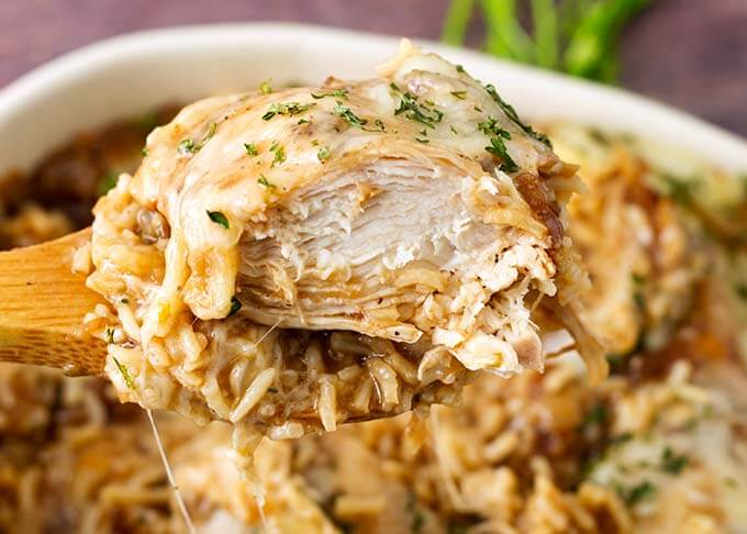Instant Pot French Onion Chicken and Rice is deliciously oniony and is a quick meal to make on a busy weeknight. Pressure cooker French onion chicken and rice is delicious! simplyhappyfoodie.com #instantpotchickenrice #instantpotfrenchonionchickenrice